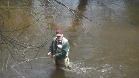 Looking down on river fly fisherman closeup Stock Video Footage