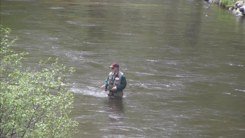Looking down on river fly fisherman medium shot Stock Video Footage