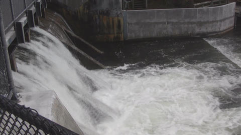 Water flowing over dam Footage