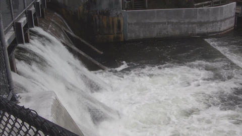 Water flowing over dam Stock Video Footage