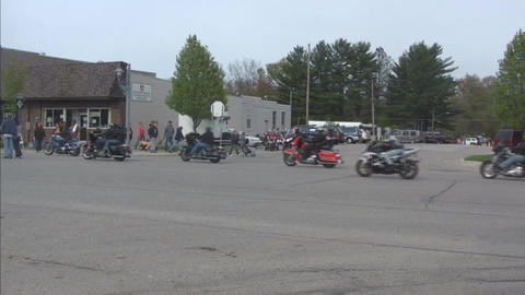 Motorcycle gathering with passersby 2 Stock Video Footage