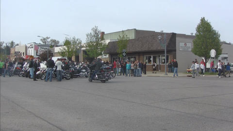 Motorcycle group parked in main street Stock Video Footage