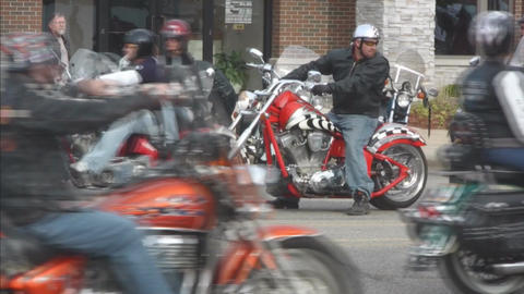 Motorcycles passing slow speed 2 Stock Video Footage