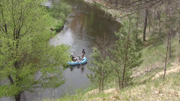 River scene with boat in distance moving away Stock Video Footage