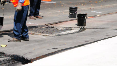 Construction workers preparing road surface Footage