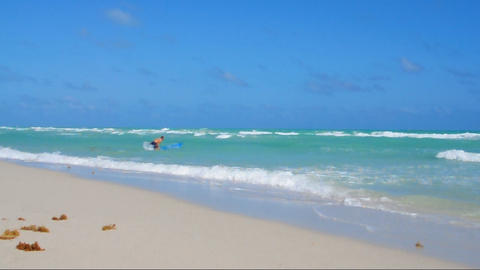 Surfer on beach Footage