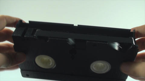 Checking The Tape On An Old VHS Tape, Isolated On  Live Action
