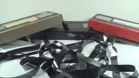 Broken VHS Cassettes, Loose Tape, Isolated On Whit Live Action