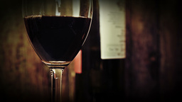 Wine glass with red wine and bottle HD stock foota Footage