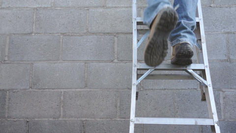Male Climbing a Step Ladder Footage