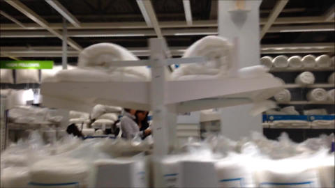 Fast motion of people shopping inside Ikea store Footage
