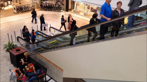One side of people in fast motion moving escalator Footage