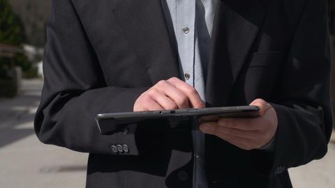Businessman using digital tablet ライブ動画