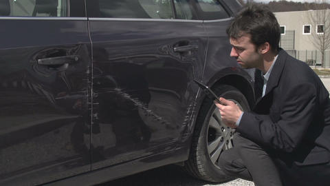 Inspector checking car crash damage Footage