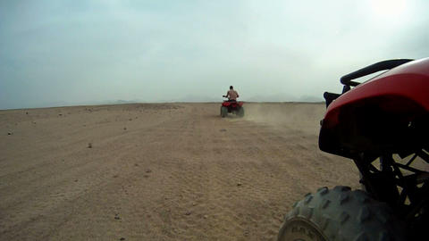 Driving quadbike trough the desert Footage