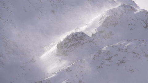 SLOW MOTION: Strong wind blowing the snowflakes Footage