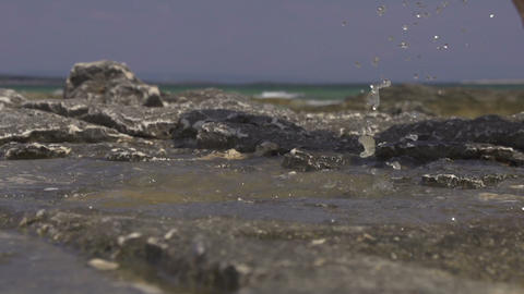 SLOW MOTION: Stepping into the sea water Footage