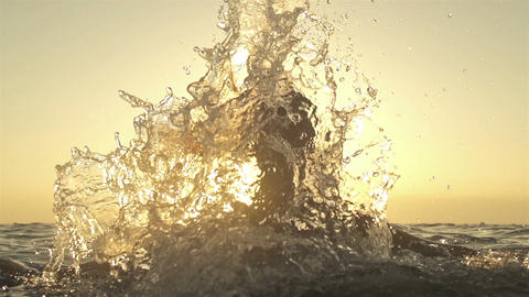SLOW MOTION: Young woman splashing water with her  Footage