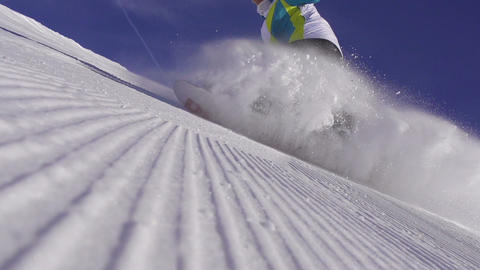 SLOW MOTION: Snowboarder sprays snow into the came Footage