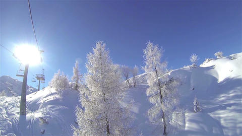 Ski Lift Ride On Sunny Day stock footage