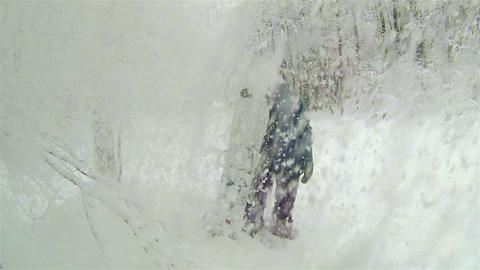 Female snowboarder in wintry landscape Footage