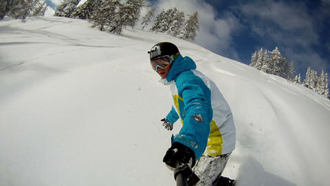 Snowboarder riding powder Footage