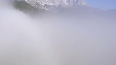 AERIAL: Rising up from the fog towards the mountai Footage
