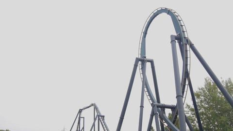 SLOW MOTION: Upside Down Roller Coaster Ride stock footage
