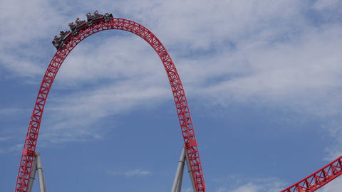 SLOW MOTION: People riding the roller coaster Footage