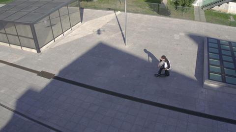 AERIAL: Skater in big city Live Action