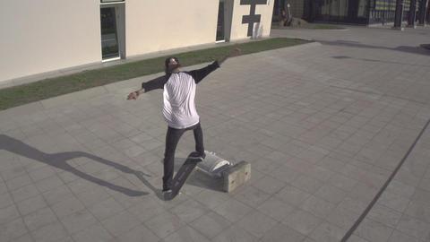 AERIAL SLOW MOTION: Skateboarder does a kick flip Footage