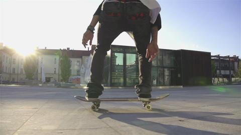 Skateboarder does flip at sunset Footage