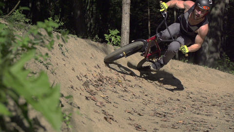 SLOW MOTION: Bmx biker riding a dirt wall Footage