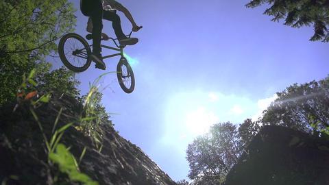 SLOW MOTION: Bmx biker performs a trick Footage