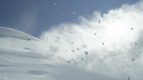SLOW MOTION: Snowboarder jumps backflip in powder Footage