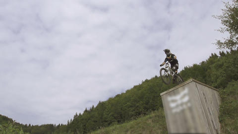 SLOW MOTION: Mountain biker jumping high Footage