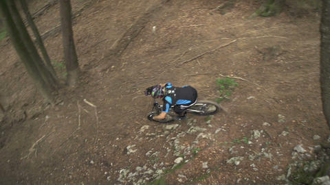 SLOW MOTION: Downhill biker riding through the for Footage
