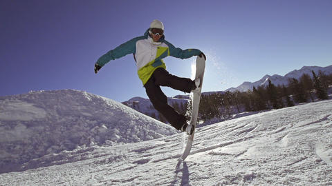 SLOW MOTION: Snowboard tail block Footage