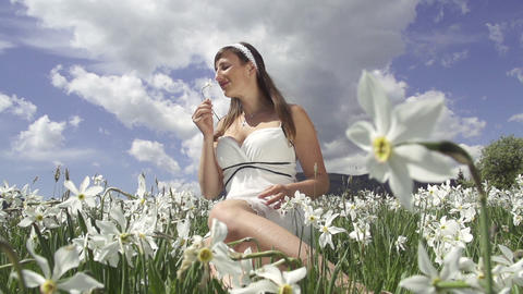 SLOW MOTION: Woman smelling flowers Footage