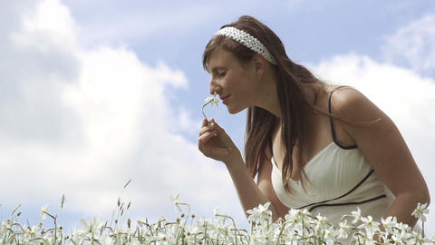 SLOW MOTION: Cheerful Girl Smelling White Flower stock footage