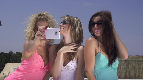 SLOW MOTION: Attractive women taking selfies Footage