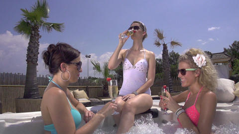 SLOW MOTION: Young women drinking champagne in jac Footage