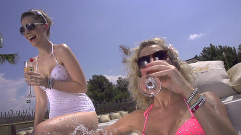 SLOW MOTION: Young woman having a drink in jacuzzi Footage