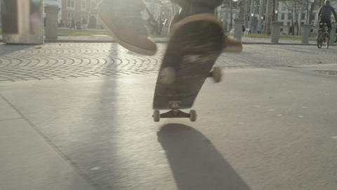 SLOW MOTION: Skateboarder performs a trick Footage
