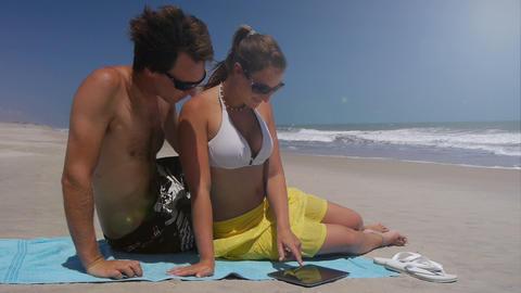 Girl using digital tablet when her boyfriend arriv Footage