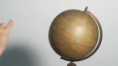 Woman hand spinning a globe and picking where to g Footage