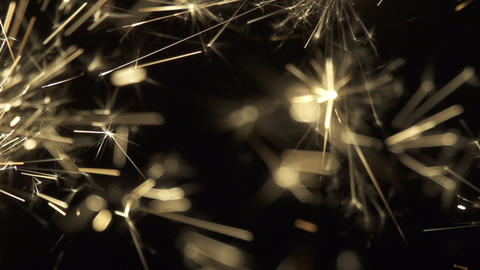 SLOW MOTION: Golden sparkles Footage