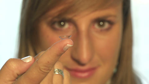 Defocused woman holding contact lens in front of h Footage