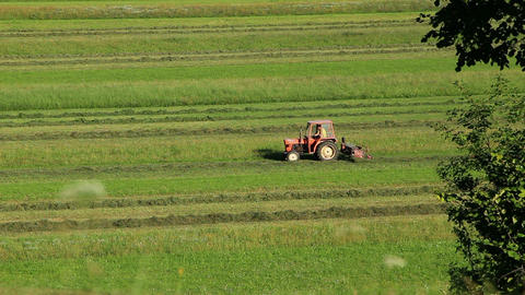 Tractor Collecting Hay stock footage