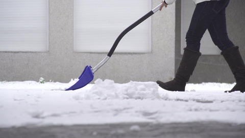 SLOW MOTION: Shoveling Snow Live Action
